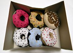 Any child will be happy to get a dozen of Sock Donuts this Christmas. You'll be amazed at how creative you can be with your old socks and some basic craft materials. Use felt and colorful embroidery floss to add details to this delicious-looking DIY Sock Crafts, Fun Crafts, Crafts For Kids, Felt Food, Play Food, Creative Play, Diy Christmas Gifts, Christmas Ideas, Xmas
