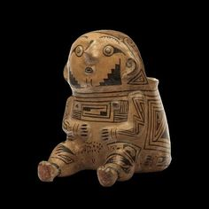 メキシコ国立博物館のHPから。http://www.mna.inah.gob.mx/coleccion/pieza-596/ficha-basica.html … 宇宙服をきてるみたいなテラコッタ像、紀元前1100-1300年