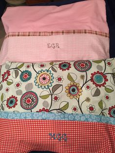 Quilts should be stored, when not in use, folded and in a pillowcase.    I make a personalized pillowcases with the same fabric from the quilt to deliver my quilts.