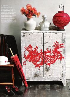 Dressers and cabinets can become pieces of creative expression. This oriental theme cabinet is so gorgeous! The newspaper base is easy, use decals to add more details. How quirky are those cord door pulls!
