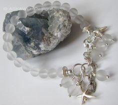 *Zauberhaftes Bettelarmband aus Bergkristallperlen mit div. Silberanhängern.*
