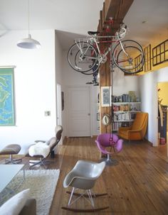 seriously like this bike storage.and indoor swing.just need this house Casa Loft, Loft House, Living Room Storage, Living Room Chairs, Dining Chairs, Storage Room, Apartment Therapy, Hanging Bike Rack, Garage Velo