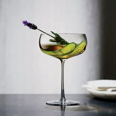 The Perfect Bloom 1/4 ounce 12-year Japanese whisky, such as Hakushu, in an atomizer 2 ounces floral gin 1/2 ounce French blanc vermouth, such as Dolin 1/2 ounce Amaro Montenegro 1/4 ounce chilled verjus 3 thin cucumber slices and fresh lavender sprigs (optional), for garnish