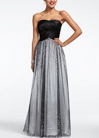 Long and luxurious, you are the center of attention in this striking prom dress. Strapless satin bodice features stunning banded detail on bust. Long sparkling glitter skirt adds drama to this already sensational number. Fully lined. Back zip. Imported polyester. Spot clean only. COMING SOON to stores and online. Available in Plus sizes as Style 211S38330W.A popular neckline for brides seeking a stylish and versatile look (offering unlimited jewelry and accessory options).A smooth fabric…