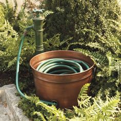 Copper hose pot for the garden - looks great with copper accent lighting.