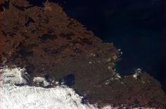 "Chris Hadfield ""Distinctive straight, deep harbor cut leading to Ballina, Ireland."""