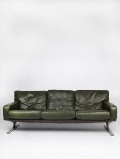 We ship worldwide! Mid-century modern design green leather comfortable three seater sofa with stylish chrome legs.