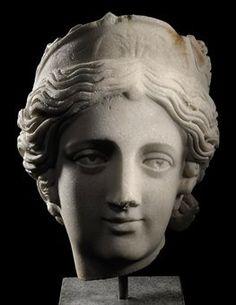 A ROMAN MARBLE HEAD OF A GODDESS CIRCA 150-200 A.D.