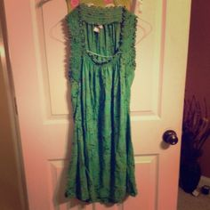Dragonfly mint/turquoise dress #adorable in #likenew condition #mint dress almost #turquoise in color. Has very appealing #flowerprint (bamboos and leafs it looks like. I'm 5'5 and it alittle #aboveknee. Has very #flattering detail around the straps/neck Dragonfly Dresses