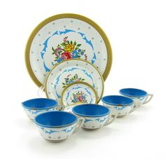 """Tin Tea Set Ohio Art Vintage Play Cups, Plates, Saucers Blue Flowers, Gold Trim. $30.00, via Etsy.   """"The Ohio Art Co., Bryan Ohio""""  4 tea cups and one creamer measuring 1 inch tall, 1.25 inches in diameter  1 plate measuring 6 3/8 inches   3 plates meauring 4 inches   2 plates measuring 1 5/8 inches   1 plate measuring 1 3/8 inches"""
