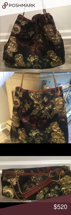 Alexander McQueen Floral Skull Canvas Handbag WOW! Amazing GENTLY used Alexander McQueen Navy Floral Skull Handbag! The color is super versatile for all seasons ... Antique brass chain on shoulder strap and 4 feet on bottom. Great brown leather detail on shoulder. Has inside zipper pocket and magnetic snap closure. Comes with dust bag. No box. No stains, snags or signs of wear. PERFECT condition. Alexander McQueen Bags Shoulder Bags
