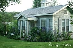 Such a  dreamy little cottage. The inside is so beautifully decorated. Be sure to check out her blog for photos of the inside.
