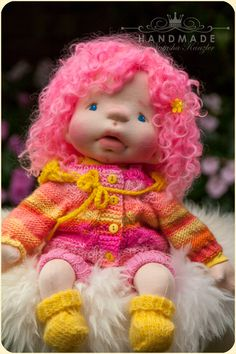Reserved for Ashley. This doll is designed for long play, to bring happiness, to be hugged and kissed... She is 15 kiddy doll with Pink hair. She will come with all outfits are shown ( knitted jacket, knitted panties, hat, mohair booties). She will also be wearing a cloth diaper. All my dolls are handcrafted according to Waldorf technique. They are firmly stuffed with wool and warm to the touch. The skin is 100% cotton, and the filling is clean carded New Zealand wool, they have lambskin…