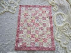 One Tiny Baby Quilt for One Tiny Baby Girl ! Shared lots of photos on my blog post of this tiny baby quilt AND free insturctions on how I made it. http://marciascraftysewing.blogspot.com/2013/10/one-tiny-baby-quilt-for-one-tiny-baby.html