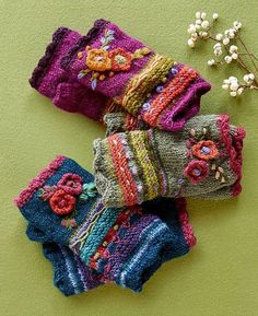 Posie Handwarmers – fleece-lined floral wool handwarmers. Posie Handwarmers – fleece-lined floral wool handwarmers.Posie Handwarmers: Our fleece-lined floral wool handwarmers add a happy note to your winter ensemble with brightly blooming flowers in a Crochet Gloves Pattern, Crochet Mittens, Knit Crochet, Crochet Hats, Knitting Projects, Crochet Projects, Hand Knitting, Knitting Patterns, Bracelet Crochet