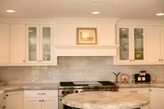 Super white granite - not as porous as marble and more stain resistant