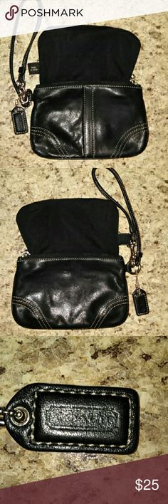 Coach Black Leather Wristlet Black leather wristlet with tan stitching & top zip. I pulled the lining out so that you can see that it is in very good condition. Gently used. Well loved. Slight peeling on strap area as shown in the picture. Just cleaned with leather cleaner. Coach Bags Clutches & Wristlets