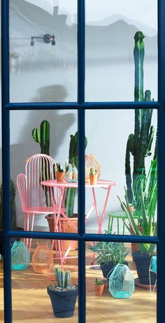 part of the cactus indoor garden collection pair with the matching cactus shaped chairs in bright coral and lush green to showcase the motif of the season