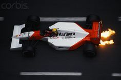 Flames shoot out from under the Formula One racecar of driver Ayrton Senna of the McLarenHonda racing team during the 1991 Monaco Grand Prix Racing Helmets, Racing Team, F1 Motor, Motor Sport, San Marino Grand Prix, Audi, Porsche, Honda, Race Party