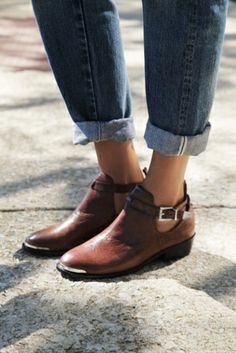 Leather ankle boots with buckle ankle straps that emphasize deep cut sides