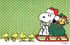 Snoopy Santa Claus on a sleigh driven by Woodstock and friends.