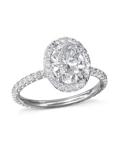 Platinum engagement ring set with a carat oval diamond center surrounded by 78 round brilliant cut diamonds around the center stone and on the band CTW, G-color, VS-clarity). Platinum Engagement Rings, Engagement Ring Settings, Thing 1, Oval Diamond, Brilliant Diamond, Ring Designs, Halo, White Gold, Clarity