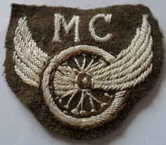 MC - Possibly Motor Cyclist. This is in unworn condition and is in heavy embroidery in brown and white on khaki with a waxed linen backing. | eBay!