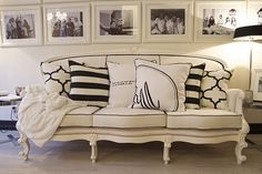 Adding a contemporary touch to this traditional couch with modern patterns on the pillows