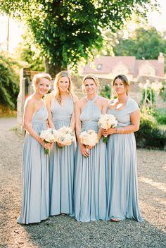 Pretty powder blue bridesmaid gowns: http://www.stylemepretty.com/2016/06/06/an-english-garden-wedding-with-the-prettiest-shades-of-powder-blue/   Photography: Ashlee Taylor - http://www.ashleetaylor.com/
