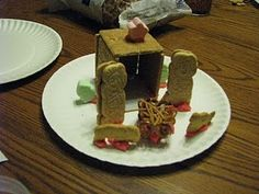 Edible nativity. Keebler cookies as Mary+Joseph, animal crackers, marshmallow star, chinese noodle manger.
