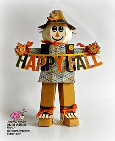 Stacey's adorable Scarecrow from LEAVES ARE FALLING SVG KIT stands tall wishing all a HAPPY FALL!  He's so proud of his buttons and bows everywhere he goes!