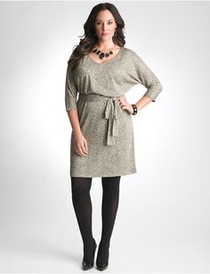 Plus Size Metallic Sweater Dress by Lane Bryant. I'd wear it with black tights, camel colored knee boots with dark gray sweater socks.
