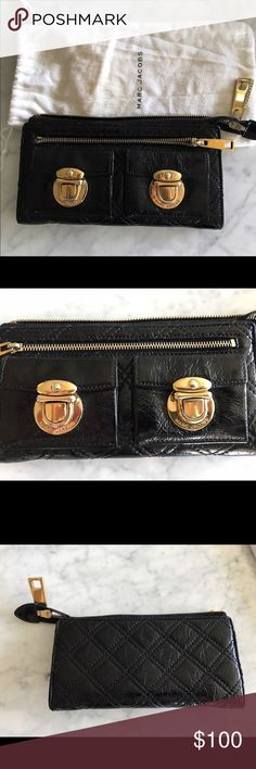 Marc Jacobs Wallet/ Clutch Marc Jacobs black quilted patent leather wallet, embossed gold tone hardware.  Multifunctional use it as a wallet or a clutch, great when traveling!  No rips, no tears but it does have some dirt stains on the inside from use. Marc Jacobs Bags Wallets