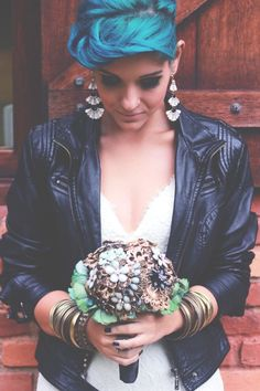 Bride wears a leather jacket! A Brazilian couple didn't want to follow tradition so planned their own version.