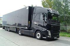 All black semi truck Volvo cab-over