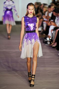 Purple is perfectly paired with a metallic edge in a flowy summer dress by Prabal Gurung. Rock it on the runway, around town, or the next time you're in Vegas.
