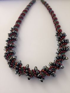 Cellini spiral with magatama beaded necklace