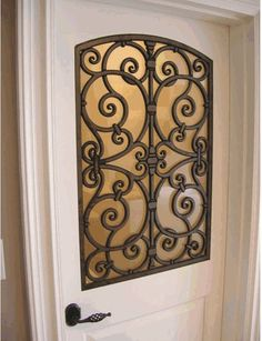 """Wrought Iron Door - really urban practical (without saying """"keep out"""")...."""