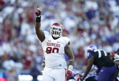 Oct 4, 2014; Fort Worth, TX, USA; Oklahoma Sooners defensive tackle Jordan Phillips (80) celebrates a turnover against the TCU Horned Frogs at Amon G. Carter Stadium. Mandatory Credit: Matthew Emmons-USA TODAY Sports