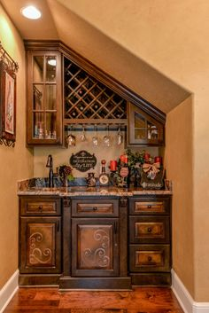 Wine bar in this Tuscan home. Faux painted cabinets add detail to this custom designed cabinet. Tuscan Style Homes, Tuscan House, Tuscan Decorating, Interior Decorating, Decorating Ideas, Küchen Design, House Design, Tuscany Decor, Kitchen Drawing