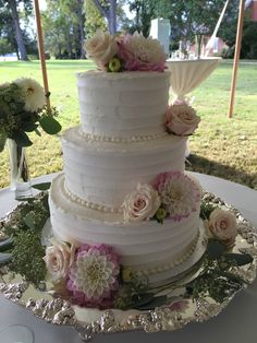Textured buttercream wedding cake with beautiful fresh flowers.