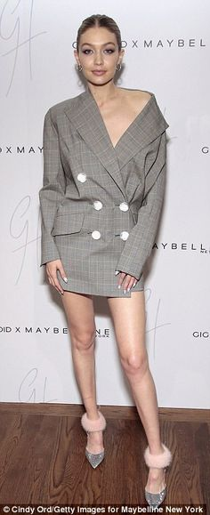 Choices, choices: Gigi Hadid donned two different shoulder-baring ensembles at a West Vill...