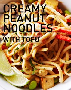 In this meal in a bowl, tender udon noodles are tossed in a smooth and creamy peanut butter sauce, along with sauted tofu, red peppers and edamame.  #BiteMeMore #recipes