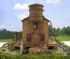Custom built HO scale structures for sale. HO scale buildings for sale. Ho Scale Buildings, Water Tower, Model Trains, Plumbing, Diorama, Cabin, Models, House Styles, Home