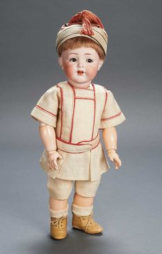 Apples - An Auction of Antique Dolls: 111 German Bisque Toddler with Flirty Eyes,Model 128,by Kammer and Reinhardt