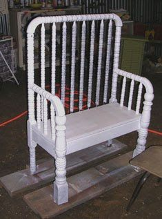 Repurpose an old crib into a bench