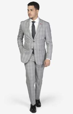Suit includes jacket & trousers 2-button single breast jacket Notch lapels Flap pockets Side vents Suit includes jacket & trousers Fit: Slim Fit Comfort: Stretch Armhole for comfort Material: 98% Wool 2% Spandex Color: Light Grey Windowpane