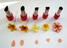 How to make clay flower petals with cutters! No detail, this picture sez it all. #polymer #clay #tutorial