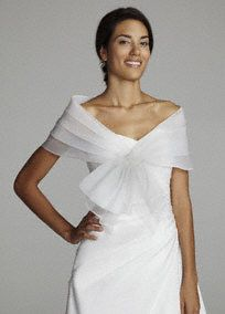 Stunning and sophisticated organza wrap is the perfect finishing touch for any classic bridal gown! Beautiful organza wrap features front claps for a simple elegant look. Available in Ivory. Fully lined. Imported polyester. Dry clean.