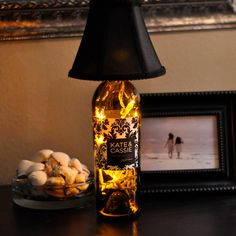 recycle a wine bottle, get a lamp shade, add mini lights (amber) ~ BOOM! you've got a handmade lamp ~ awesome idea Wine Bottle Corks, Wine Bottle Crafts, Diy Bottle, Bottles And Jars, Glass Bottles, Empty Bottles, Home Crafts, Diy Crafts, Wine Craft